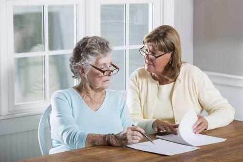 Daughter helping elder mother with paperwork