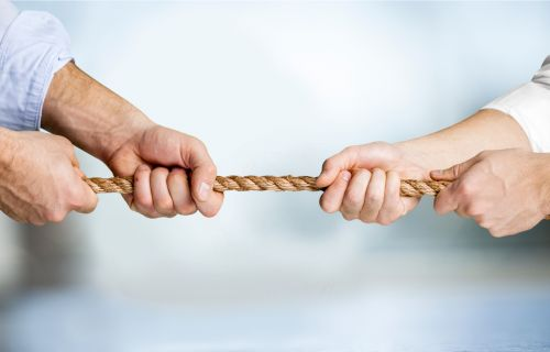 people pulling a rope in opposite directions