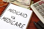 Medicaid vs Medicare written in a note.